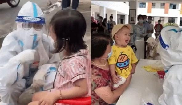 Hành động bất ngờ của nhân viên y tế khi em bé hoảng hốt vì lấy dịch họng